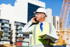 Constructeur d'ingénieur au chantier de construction Images libres de droits