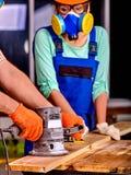 Constructeur de femme avec l'outil spécial Photo libre de droits