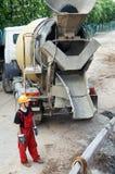Constructeur et béton de construction Image stock