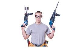 Constructeur masculin tenant des mains deux exercices, d'isolement sur le fond blanc images stock