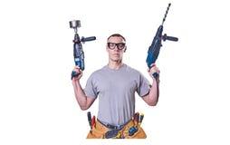 Constructeur masculin tenant des mains deux exercices, d'isolement sur le fond blanc image stock
