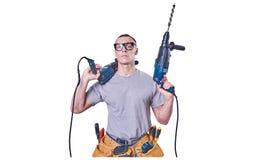 Constructeur masculin tenant des mains deux exercices, d'isolement sur le fond blanc image libre de droits