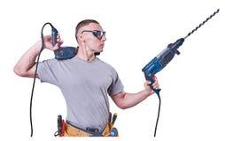 Constructeur masculin tenant des mains deux exercices, d'isolement sur le fond blanc photos libres de droits
