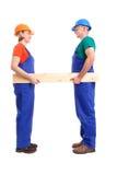 Constructeurs avec la planche photos libres de droits