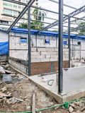 Constructing Wall on a building with metal foundation. Constructing Brick Wall on a building with metal foundation stock image