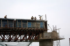 Constructing Bridge. Indian workers busy while constructing a huge bridge Royalty Free Stock Photography