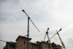 Constructing a building with big cranes. Cranes on a construction site stock photo