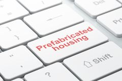 Constructing concept: Prefabricated Housing on computer keyboard background Royalty Free Stock Images