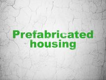 Constructing concept: Prefabricated Housing on wall background Royalty Free Stock Images