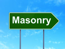 Constructing concept: Masonry on road sign background Royalty Free Stock Photo