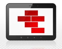 Constructing concept: Tablet Pc Computer with Bricks on display Royalty Free Stock Photos