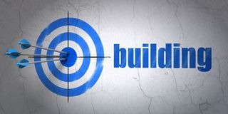 Constructing concept: target and Building on wall background. Success constructing concept: arrows hitting the center of target, Blue Building on wall background Royalty Free Stock Photography