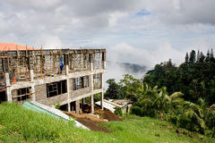 Constructing a house. House being built on a hillside with a view of the valley below Stock Photography