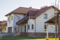 Constructing  house. Beautiful country house in alpine style. Constructing and design of building concept Stock Photography