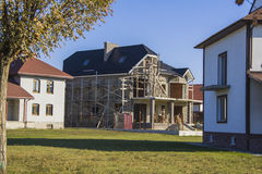 Constructing  house. Beautiful country house in alpine style. Constructing and design of building concept Stock Images