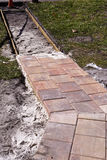 Constructing a Pathway. Building a walkway with pavers Stock Photo