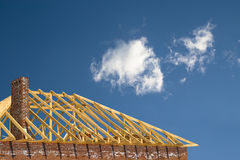 Constructing of the roof. On the sky Royalty Free Stock Photo