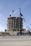 Constructing a tower of flats. Royalty Free Stock Photography