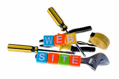 Constructing website concept. Objects and words isolated on white Royalty Free Stock Photos