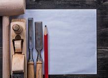 Constructio di carta pulito degli scalpelli del maglio della matita di legno piana della piallatrice Fotografia Stock