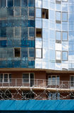 Construction. Modern building, surrounded by barbed wire Stock Photo