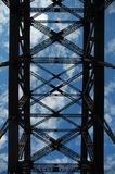 Construction. Harbour bridge construction detail photo, blue sky with clouds Stock Image