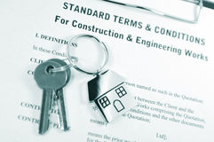 Construction. & engineering works contract with keys and symbolic keyrings Royalty Free Stock Photos