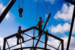 Construction. Worker high up on steel trusses Stock Photo