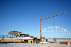 Construction. Winter building construction with crane Stock Images