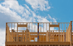 Construction. New building construction with blue sky and clouds royalty free stock photography