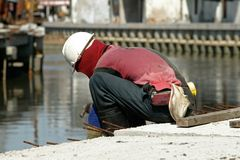 Construction. Worker on the working side Royalty Free Stock Image