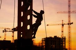 Construction. Worker high up ,sunset Stock Photo