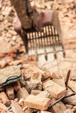 Construction. Demolisher taking down ruins of an old factory Royalty Free Stock Photography