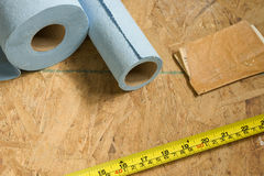 Construction. Floor lining, measuring tape, and sandpaper Stock Photography
