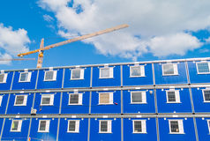 Construction. Blue barracks and a crane on a construction site Royalty Free Stock Images