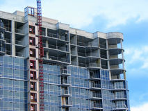 Construction 3. Apartment building under construction on the background of blue sky Royalty Free Stock Images