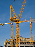 Construction. Cranes at a High Rise construction site stock images