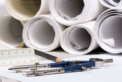 Construction. The tools of a designer with plans in the background Stock Image