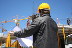 Construction. Silhouette of construction worker on site Stock Photography
