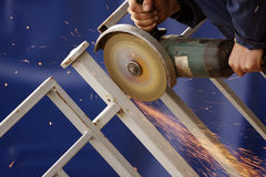 Construction. Workers operating cutting machine Royalty Free Stock Photos