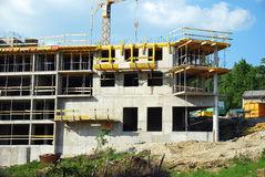 Construction. Building construction - concrete walls, crane and building accessories royalty free stock photography