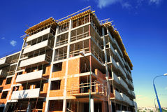 Construction. Unfinished residential building construction - brick and concrete walls royalty free stock image