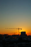 Construction. Site - cranes at dawn (vertical version Royalty Free Stock Image