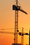 Construction. Site - cranes at dawn (vertical version Stock Image