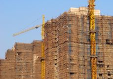 Construction. House under construction, two cranes Royalty Free Stock Photos