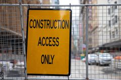 Construction access only sign on metal net fence on construction royalty free stock photos