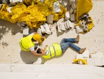 Construction accident. Construction worker has an accident while working on new house Stock Photo