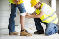 Construction accident. Construction worker has an accident while working on new house Royalty Free Stock Photos