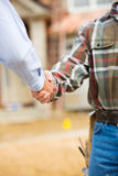 Construction: Agent and Contractor Shake Hands Stock Photos