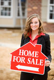 Construction: Agent Holding Home For Sale Sign Royalty Free Stock Photo